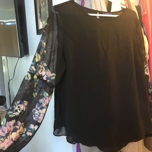 Black business top with floral sleeves